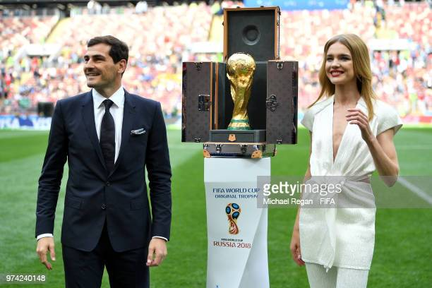 Former Spain player Iker Casillas and Supermodel Natalia Vodianova are seen next to the World Cup Trophy prior to the 2018 FIFA World Cup Russia...