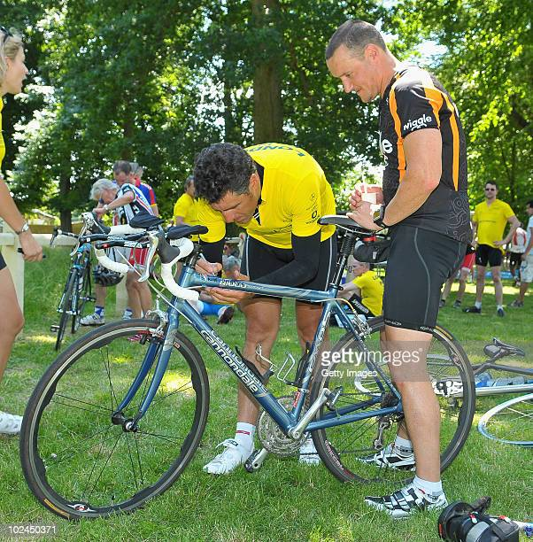 Former Spanish Cycling Champion Miguel Indurain signs an autograph during the 2010 London to Paris Bike Ride for the Laureus Sport for Good...