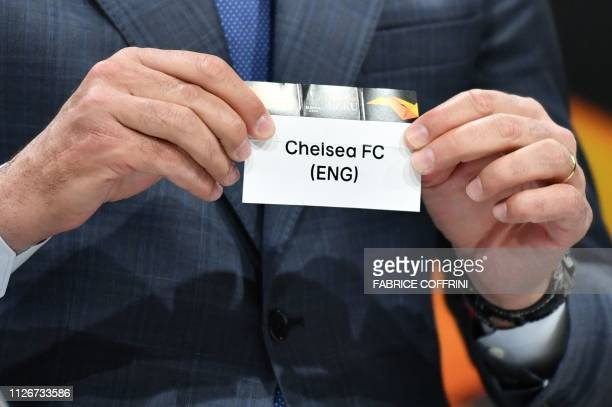 Former Spanish football player Andres Palop shows the name of Chelsea football club during the draw for the Europa League round of sixteen on...