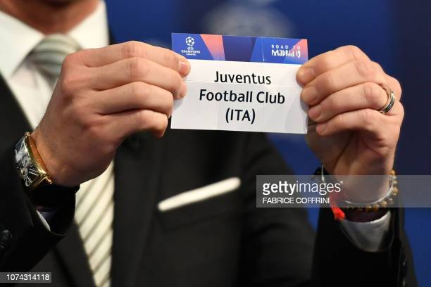 Former Spanish football player Luis Garcia shows the slip of Juventus during the draw for the round of 16 of the UEFA Champions League football...