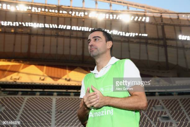 Former Spanish football professional and World Cup 2022 ambassador Xavi Hernandez looks on during a presentation at the at Khalifa International...