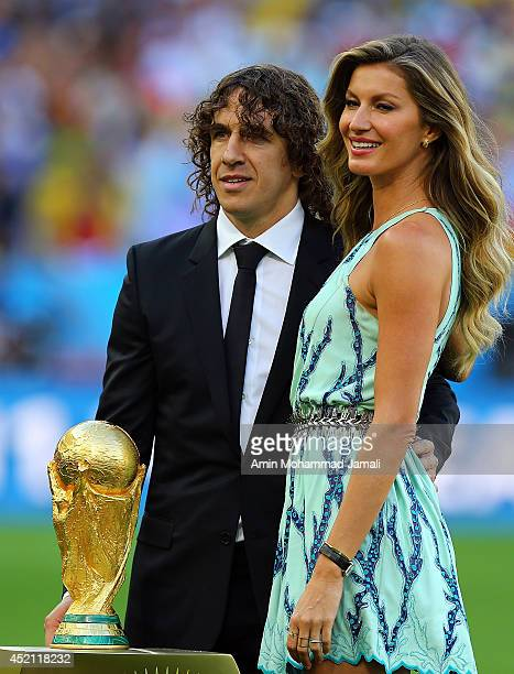 Former Spanish international Carles Puyol and model Gisele Bundchen present the World Cup trophy in a Louis Vuitton case prior to the 2014 FIFA World...