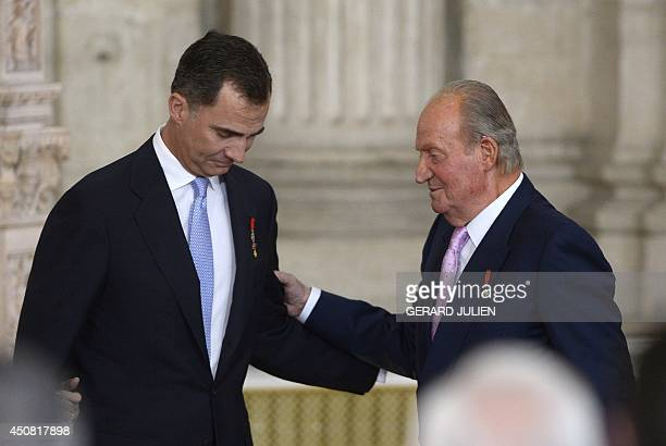 Former Spanish King Juan Carlos congratules Spain's Prince Felipe VI during the ceremony of approval and enactment of a law bringing into effect King...
