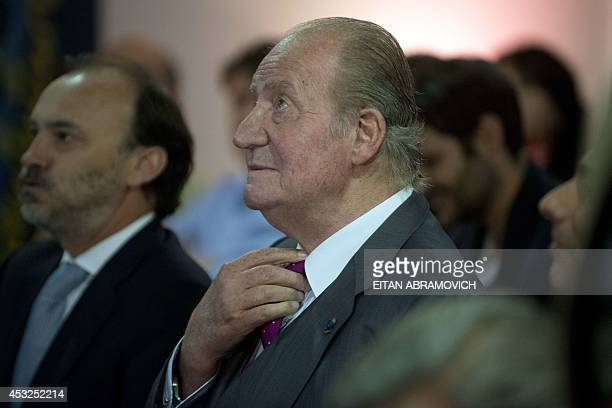 Former Spanish King Juan Carlos I of Spain attends a meeting at a Spanish company in Bogota on August 6 2014 in the framework of his visit to...