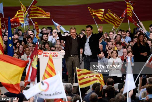 Former Spanish Prime Minister Jose Luis Rodriguez Zapatero and Spanish Socialist party leader Pedro Sanchez wave during a Catalan Socialist party...