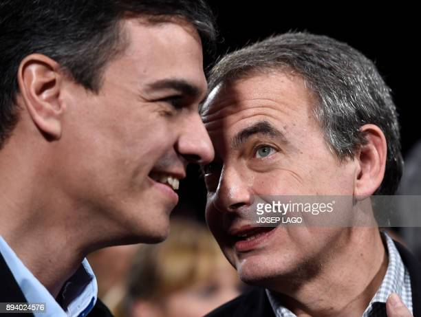 Former Spanish Prime Minister Jose Luis Rodriguez Zapatero speaks with Spanish Socialist party leader Pedro Sanchez during a Catalan Socialist party...