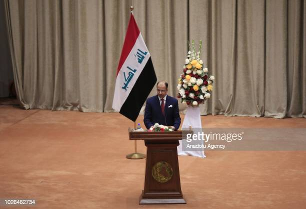 Former speaker of parliament Salim alJabouri delivers a speech during the opening session of New Iraqi parliament at the Parliament Building on...