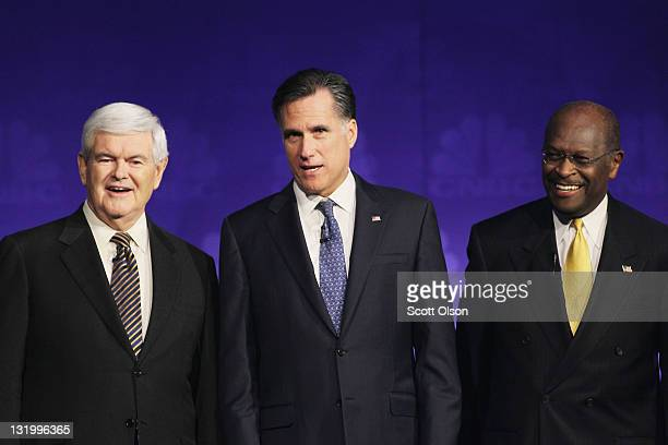 Former speaker of the house Newt Gingrich former massachusetts Gov Mitt Romney and former ceo of godfather's pizza Herman Cain look on prior to a...