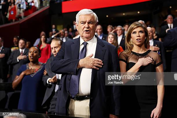 Former Speaker of the House Newt Gingrich stands during a performance of the 'StarSpangled Banner' prior to the start of the evening session on the...