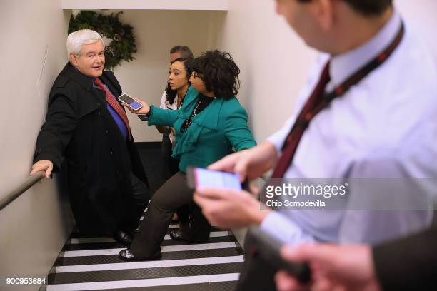 Former Speaker of the House Newt Gingrich talks with reporters including April Ryan at the White House following Press Secretary Sarah Huckabee...