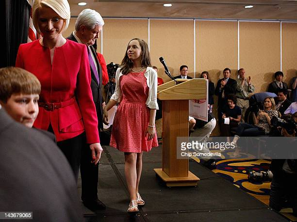 Former Speaker of the House Newt Gingrich walks off the stage with his granddaughter Maggie Cushman his grandson Robert Cushman and his wife Callista...