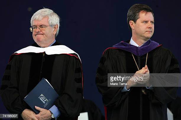 Former Speaker of the House of Representatives Newt Gingrich and Jerry Falwell Jr look on during the school's 34th commencement ceremony the first...