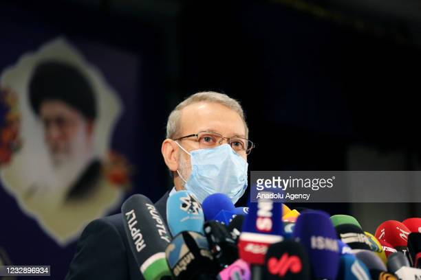 Former speaker of the Parliament of Iran Ali Larijani spaeks to the press after registering his candidacy for Iran's presidential elections, at the...