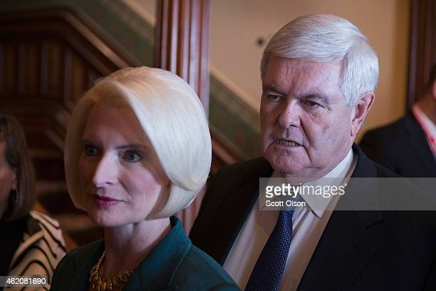 Former Speaker of the US House of Representatives Newt Gingrich and his wife Callista attend the Iowa Freedom Summit on January 24 2015 in Des Moines...