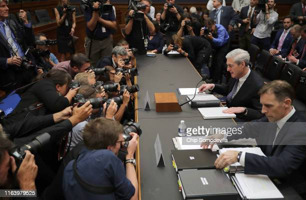Former Special Counsel Robert Mueller and former Deputy Special Counsel Aaron Zebley arrive to testify before the House Intelligence Committee about...