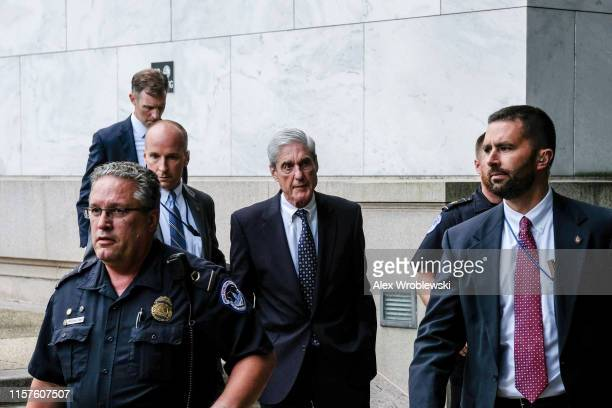 Former Special Counsel Robert Mueller departs after testifying to the House Intelligence Committee about his report on Russian interference in the...