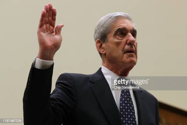 Former Special Counsel Robert Mueller is sworn in before testifying before the House Judiciary Committee about his report on Russian interference in...