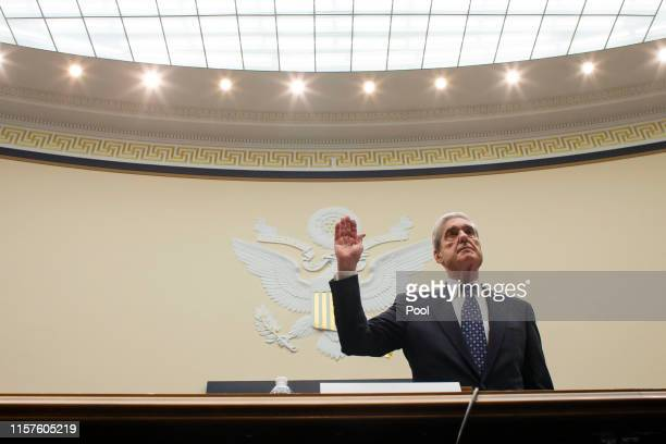 Former Special Counsel Robert Mueller is sworn in before testifying before a House Judiciary Committee hearing about his report on Russian...
