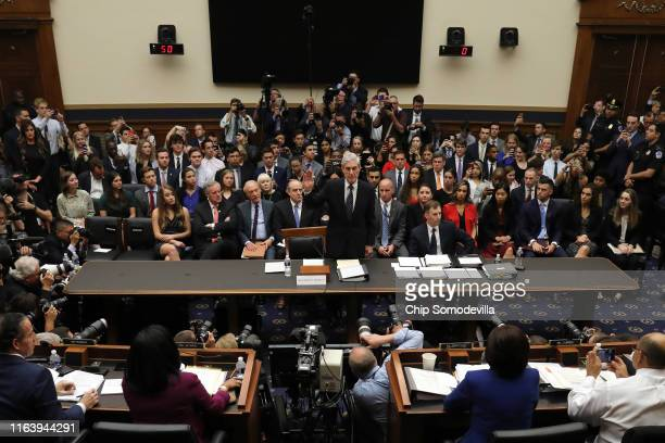 Former special counsel Robert Mueller is sworn in before testifying to the House Judiciary Committee about his report on Russian interference in the...