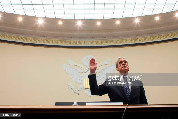 Former Special Counsel Robert Mueller is sworn in to testify before the House Judiciary Committee hearing on his report on Russian election...