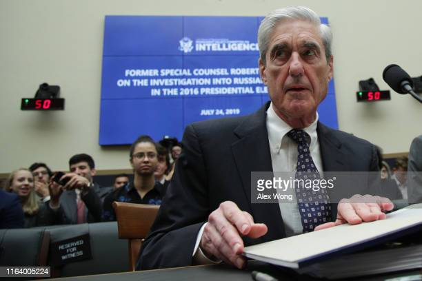 Former Special Counsel Robert Mueller waits to testify before the House Intelligence Committee about his report on Russian interference in the 2016...