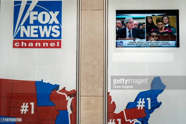 Former Special Counsel Robert Mueller's testimony to Congress is shown on a screen outside of the Fox News headquarters on July 24, 2019 in New York...