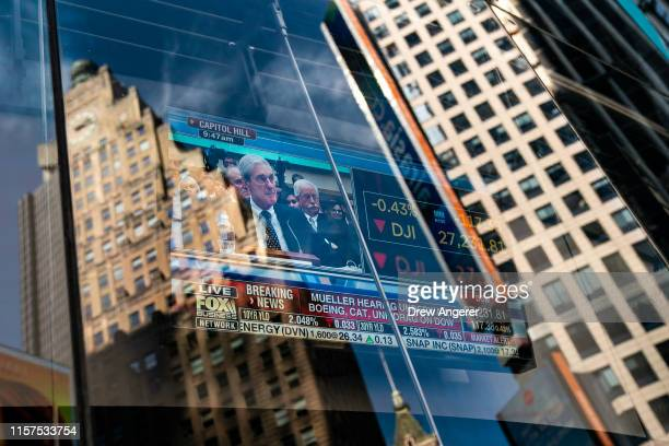 Former Special Counsel Robert Mueller's testimony to Congress is shown on a television screen in Times Square on July 24, 2019 in New York City....