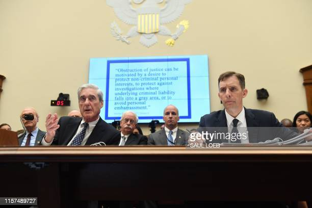Former Special Prosecutor Robert Mueller , with former Deputy Special Counsel Aaron Zebley, testifies before Congress on July 24 in Washington, DC. -...