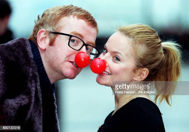 Former Spice Girl Geri Halliwell and TV and radio presenter Chris Evans in Leicester Square London to help launch the 1998 Comic Relief appeal The...