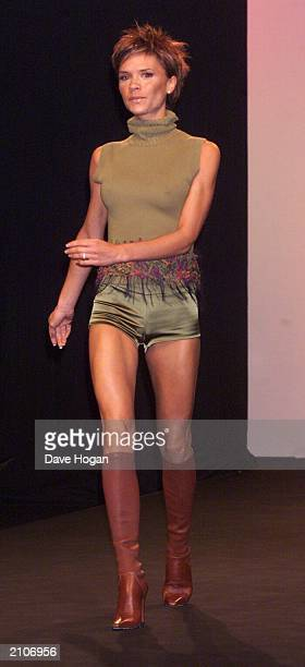 Former Spice Girl Victoria Beckham makes her catwalk debut at London Fashion Week on February 16 2000 at the Natural History Museum South Kensington...