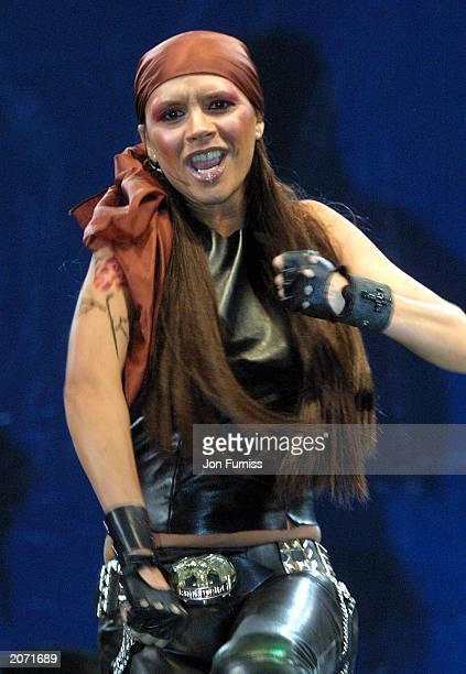 Former Spice Girl Victoria Beckham performs on stage at Radio Station BRMB's Party in the Park in Birmingham Englandl on August 27 2001 The singer...