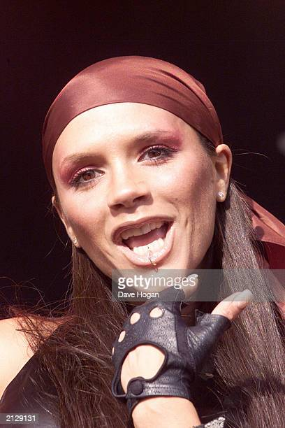 Former Spice Girl Victoria Beckham performs on stage at Radio Station BRMB's Party in the Park in Birmingham England on August 27 2001 The singer was...