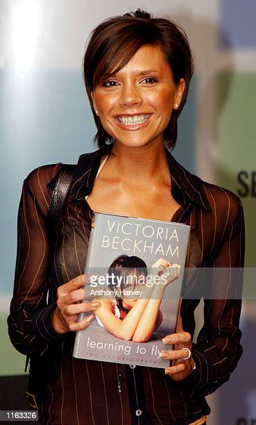 Former Spice Girl Victoria Beckham poses for photographers September 17 2001 during a signing session to launch her autobiography 'Learning to Fly'...