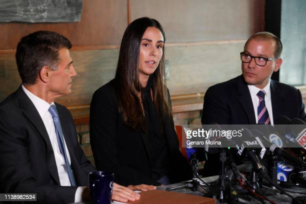 LOS ANGELES CA APRIL 23 2019 Former sports reporter Kelli Tennant center and her attorneys Garo Mardirossian left and David de Robertis hold a news...