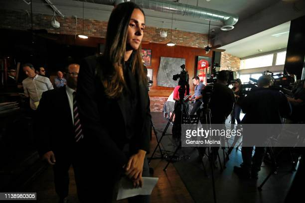 LOS ANGELES CA APRIL 23 2019 Former sports reporter Kelli Tennant walks past members of the media after holding a news conference to discuss her...