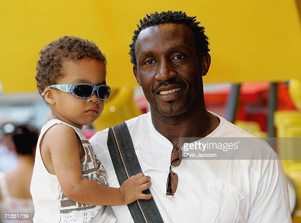 Former sprinter Linford Christie and his son pose for photographs at the Bob The Builder Built To Be Wild UK Premiere at the Odeon West End in...