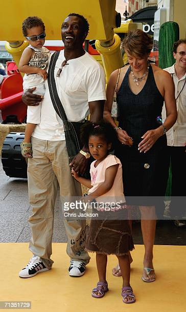 Former sprinter Linford Christie poses for photographs with his family at the Bob The Builder Built To Be Wild UK Premiere at the Odeon West End in...
