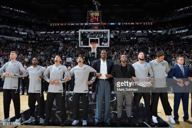 Former Spurs David Robinson and Kawhi Leonard of the San Antonio Spurs with his teammates stand for the National Anthem before the game against the...