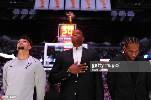 Former Spurs David Robinson with Derrick White and Kawhi Leonard of the San Antonio Spurs stand for the National Anthem before the game against the...