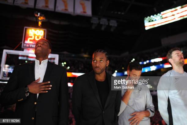 Former Spurs David Robinson with Kawhi Leonard of the San Antonio Spurs and his teammates stand for the National Anthem before the game against the...