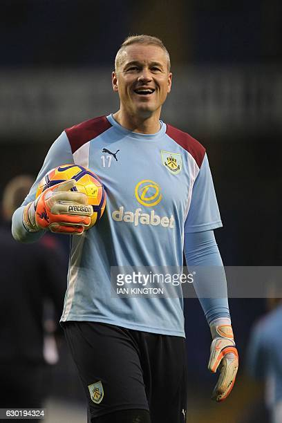 Former Spurs keeper, Burnley's English goalkeeper Paul Robinson smiles as he warms up ahead of the English Premier League football match between...