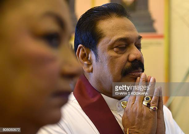 Former Sri Lankan president and Member of Parliament Mahinda Rajapaksa and wife Shiranthi Rajapaksa offer prayers at a Hindu temple in Colombo on...
