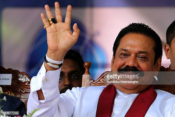 Former Sri Lankan president and parliamentary candidate Mahinda Rajapaksa waves to supporters during his partyfs final day of election campaign...