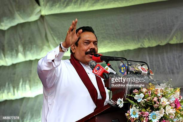 Former Sri Lankan president and parliamentary candidate Mahinda Rajapaksa speaks to voter during his party's rally on the final day of the election...