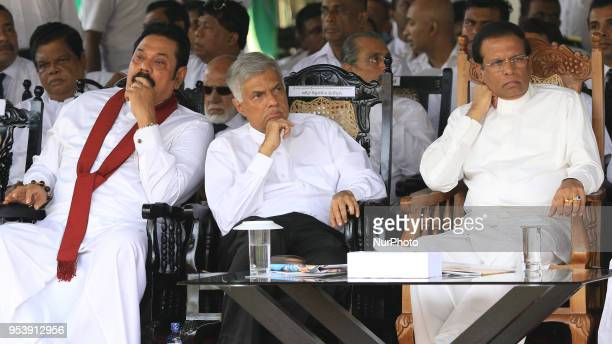 Former Sri Lankan President Mahinda Rajapaksa Sri Lankan Prime minister Ranil Wickremesinghe and Sri Lankan president Maithripala Sirisena look on...