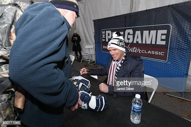 Former St. Louis Blues player Pierre Turgeon signs autographs for fans at The Pregame prior to the 2017 Bridgestone NHL Winter Classic at Busch...