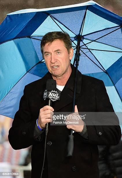 Former St Louis Blues player Wayne Gretzky speaks with the NHL Network prior to the 2017 Bridgestone NHL Winter Classic at Busch Stadium on January 2...