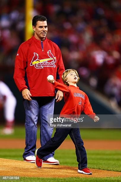 Former St Louis Cardinal Jim Edmonds and his son Landon deliver the ceremonial first pitch prior to Game Two of the National League Championship...