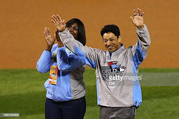 Former St Louis Cardinals outfielder So Taguchi and Amanda Richardson wave to the crowd prior to Game Four of the 2013 World Series between the...
