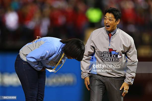 Former St Louis Cardinals outfielder So Taguchi and Amanda Richardson stand on the field prior to Game Four of the 2013 World Series between the...
